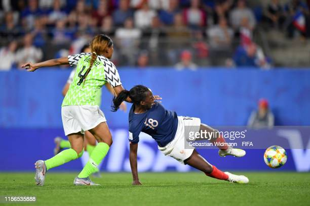 Viviane Asseyi of France is fouled by Ngozi Ebere of Nigeria leading to a penalty and also a second yellow and therefore a red card for Ngozi Ebere...
