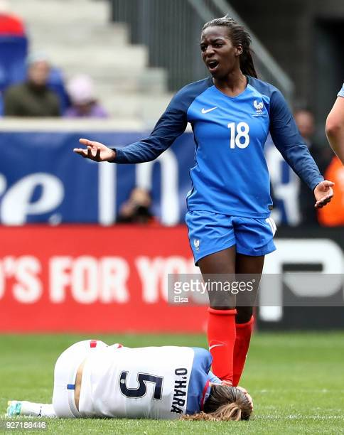 Viviane Asseyi of France is given a yellow card after she collided with Kelley O'Hara of United States of America in the first half during the...