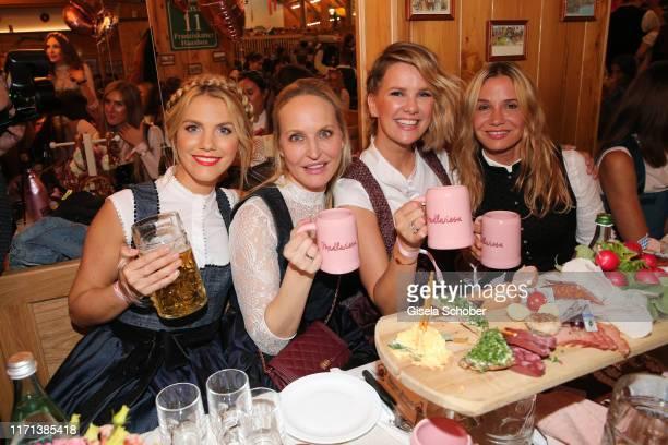 "Viviane Geppert, Anne Meyer-Minnemann, Monica Ivancan and Nadeshda Brennicke during the ""Madlwiesn"" as part of the Oktoberfest 2019 at Theresienwiese..."