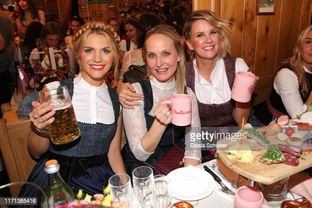 "Viviane Geppert, Anne Meyer-Minnemann, Monica Ivancan during the ""Madlwiesn"" as part of the Oktoberfest 2019 at Theresienwiese on September 26, 2019..."