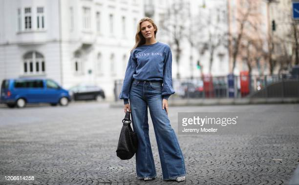 Viviane Geppert wearing Ganni pants, Anine Bing sweater and Bottega Veneta bag on February 14, 2020 in Munich, Germany.