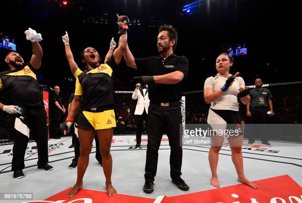 Viviane Pereira of Brazil celebrates after her unanimousdecision victory over Jamie Moyle in their womens strawweight bout during the UFC 212 event...