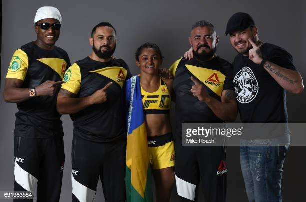 Viviane Pereira of Brazil poses for a portrait backstage with her team after her victory over Jamie Moyle during the UFC 212 event at Jeunesse Arena...