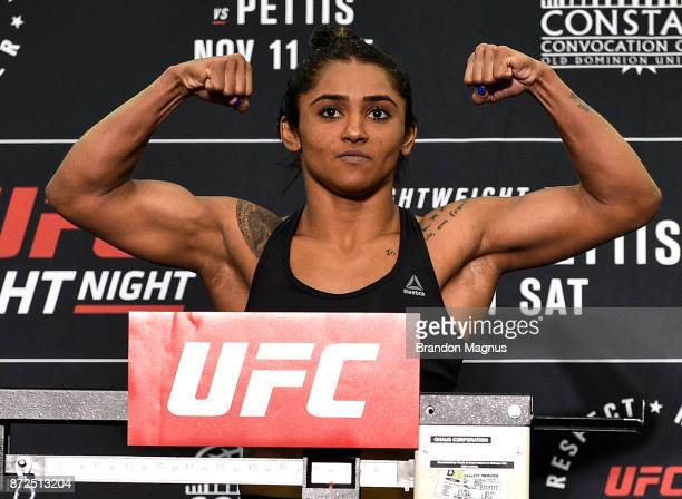 Viviane Pereira of Brazil poses on the scale during the UFC Fight Night Weighin on November 10 2017 in Norfolk Virginia