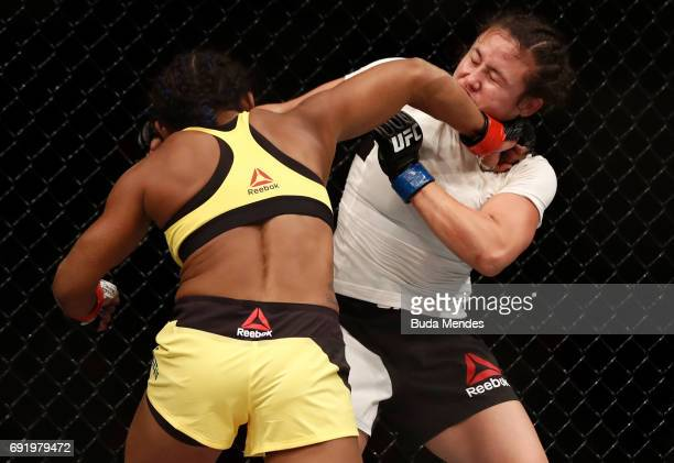 Viviane Pereira of Brazil punches Jamie Moyle in their womens strawweight bout during the UFC 212 event at Jeunesse Arena on June 3 2017 in Rio de...