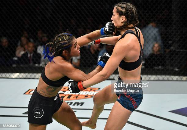 Viviane Pereira of Brazil punches Tatiana Suarez in their women's strawweight bout during the UFC Fight Night event inside the Ted Constant...