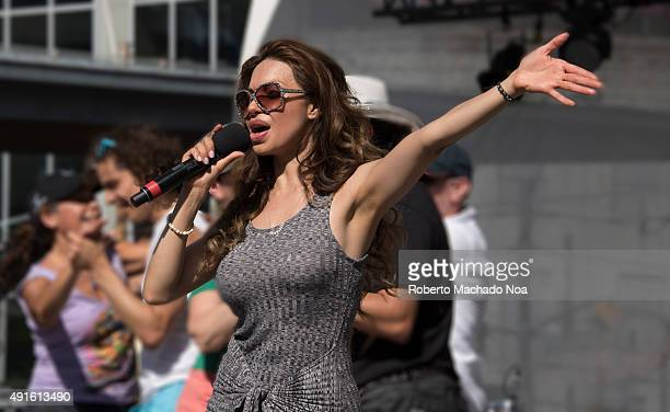 SQUARE TORONTO ONTARIO CANADA Vivianna Castel singing on stage and waving her hand at MexFest 2015 MexFest 2015 is celebration of all things Mexican...