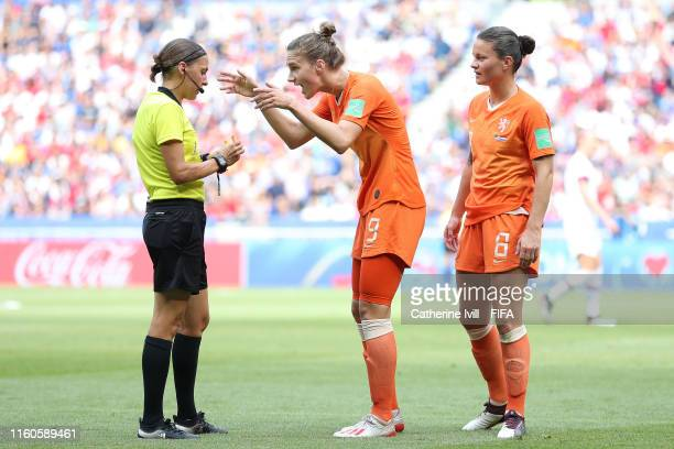 Vivianne Miedema and Sherida Spitse of the Netherlands speak to match referee Stephanie Frappart during the 2019 FIFA Women's World Cup France Final...