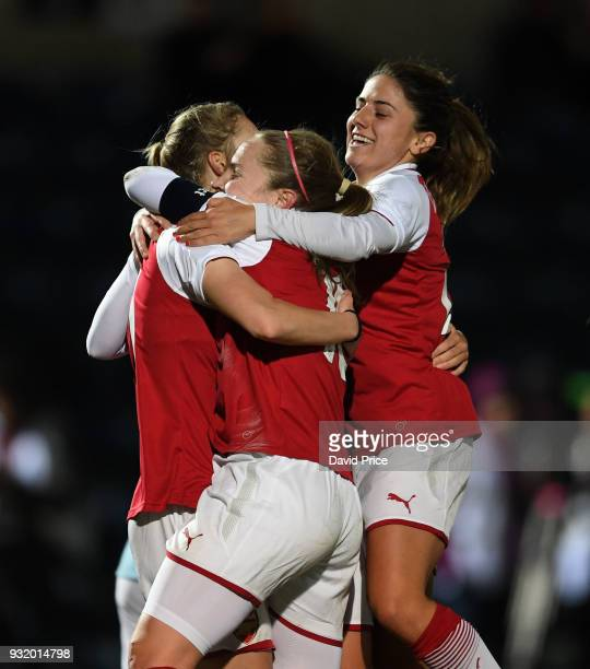 Vivianne Miedema celebrates scoring a goal for Arsenal with Kim Little and Danielle van de Donk during the match between Arsenal Women and Manchester...