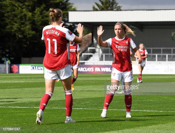 Vivianne miedema celebrates scoring Arsenal's 2nd goal with Jordan Nobbs during the match between Arsenal Women and Reading Women at Meadow Park on...