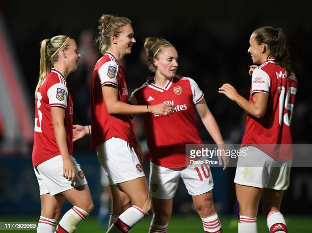 Vivianne Miedema celebrates scoring Arsenal's 2nd goal with Kim Little and Katie McCabe during the UEFA Women's Champions League match between...