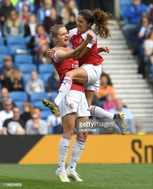 Vivianne Miedema celebrates scoring goal for Arsenal with Danielle van de Donk during the match between Brighton Hove Albion Women and Arsenal Women...