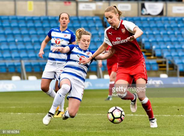 Vivianne Miedema of Arsenal battles for possession with Harriet Scott of Reading FC Women during Women's Super League 1 match between Reading FC...