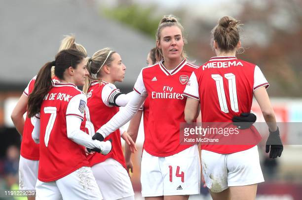 Vivianne Miedema of Arsenal celebrates with Jill Roord and Danielle Van De Donk after scoring her sides sixth goal during the Barclays FA Women's...