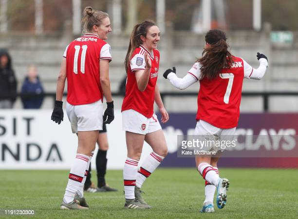 Vivianne Miedema of Arsenal celebrates with Lisa Evans and Danielle Van De Donk after scoring her sides eighth goal during the Barclays FA Women's...