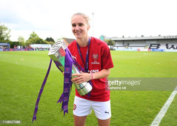 Vivianne Miedema of Arsenal celebrates with the trophy after the WSL match between Arsenal Women and Manchester City at Meadow Park on May 11 2019 in...