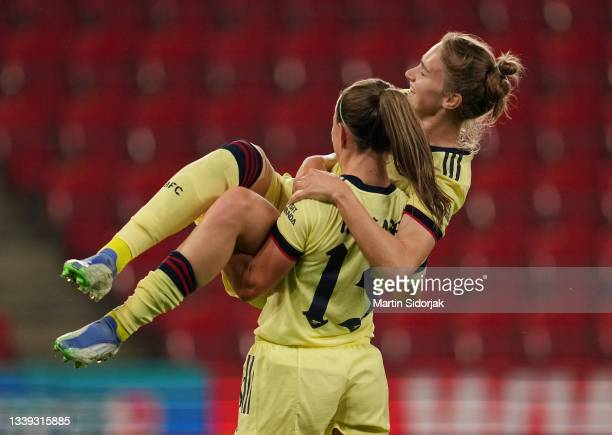Vivianne Miedema of Arsenal FC celebrates with Katie McCabe after scoring their team's third goal and completing her hat-trick during the UEFA...