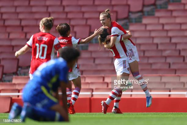 Vivianne Miedema of Arsenal FC celebrates with team mates after scoring their team's first goal during the Barclays FA Women's Super League match...
