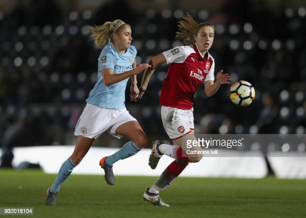Vivianne Miedema of Arsenal is challenged by Steph Houghton of Manchester City during the WSL Continental Cup Final between Arsenal Women and...