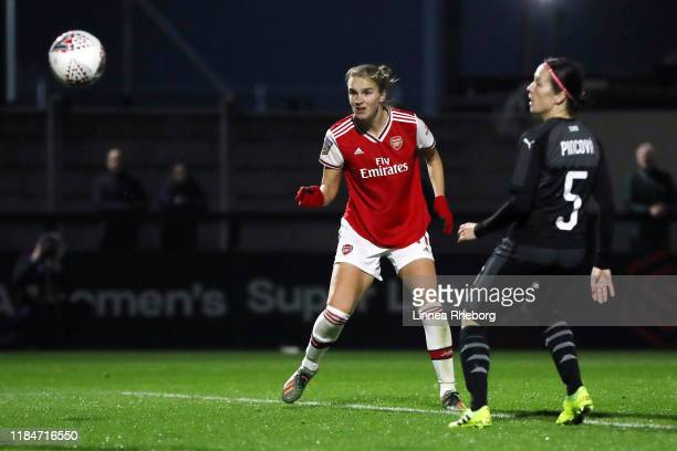 Vivianne Miedema of Arsenal scores her team's eighth goal during the UEFA Women's Champions League Round of 16 Second Leg match between Arsenal Women...