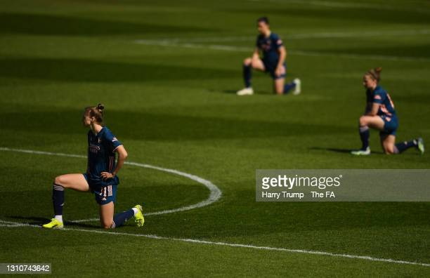 Vivianne Miedema of Arsenal takes a knee in support of the 'Black Lives Matter' movement prior to the Barclays FA Women's Super League match between...