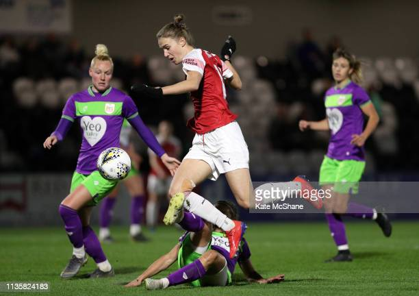 Vivianne Miedema of Arsenal Women jumps over Loren Dykes of Bristol City on her way to scoring her team's first goal during the The Football...