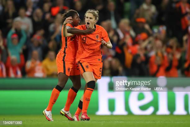 Vivianne Miedema of Netherlands celebrates after scoring their side`s first goal with teammate Lineth Beerensteyn of Netherlands during the FIFA...