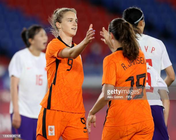 Vivianne Miedema of Team Netherlands celebrates with teammate Renate Jansen after scoring their side's fifth goal during the Women's Group F match...