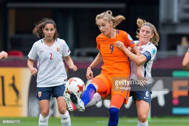 Vivianne Miedema of the Netherlands and Maren Mjelde of Norway battle for the ball during their Group A match between Netherlands and Norway during...