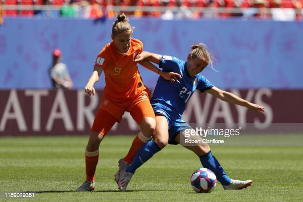 Vivianne Miedema of the Netherlands battles for possession with Valentina Cernoia of Italy during the 2019 FIFA Women's World Cup France Quarter...