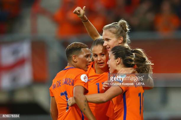 Vivianne Miedema of the Netherlands celebrates the first goal with Shanice van de Sanden , Lieke Martens and Danielle van de Donk during the UEFA...