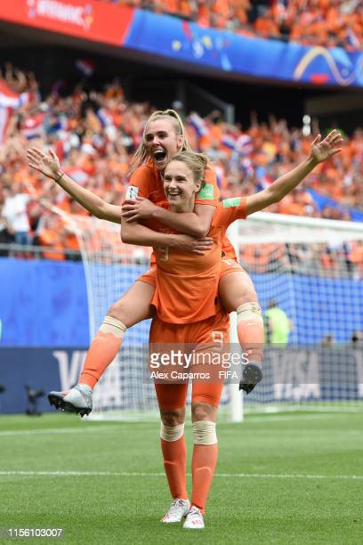 Vivianne Miedema of the Netherlands celebrates with teammate Jill Roord after scoring her team's third goal during the 2019 FIFA Women's World Cup...