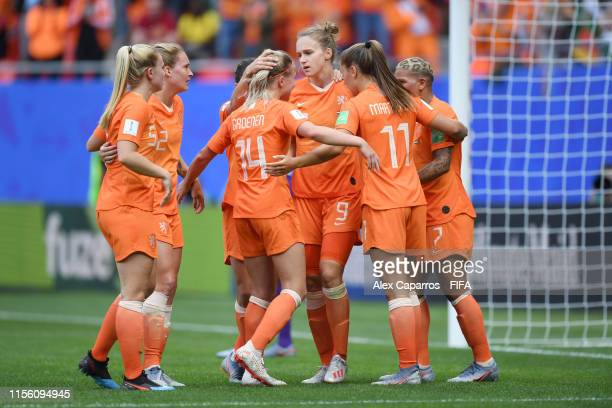 Vivianne Miedema of the Netherlands celebrates with teammates after scoring her team's first goal during the 2019 FIFA Women's World Cup France group...