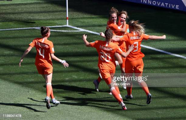 Vivianne Miedema of the Netherlands celebrates with teammates after scoring her team's first goal during the 2019 FIFA Women's World Cup France...