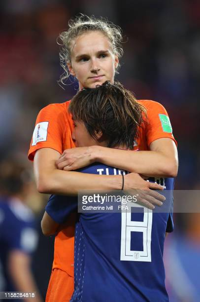 Vivianne Miedema of the Netherlands consoles Mana Iwabuchi of Japan following Japan's defeat in the 2019 FIFA Women's World Cup France Round Of 16...