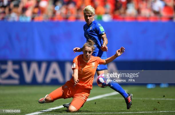 Vivianne Miedema of the Netherlands is fouled by Elena Linari of Italy during the 2019 FIFA Women's World Cup France Quarter Final match between...