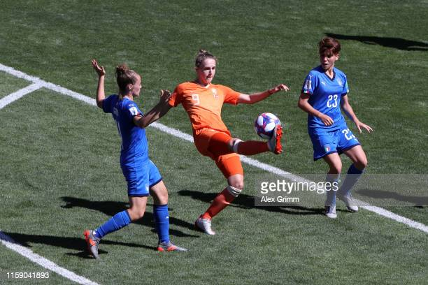 Vivianne Miedema of the Netherlands is put under pressure by Manuela Giugliano and Aurora Galli of Italy during the 2019 FIFA Women's World Cup...