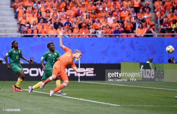 Vivianne Miedema of the Netherlands scores her team's first goal during the 2019 FIFA Women's World Cup France group E match between Netherlands and...