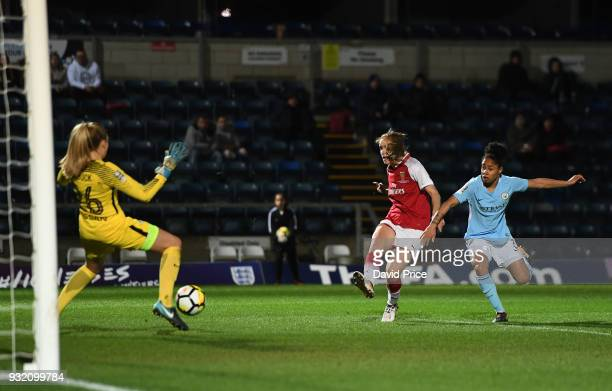 Vivianne Miedema scores a goal for Arsenal during the match between Arsenal Women and Manchester City Ladies at Adams Park on March 14 2018 in High...