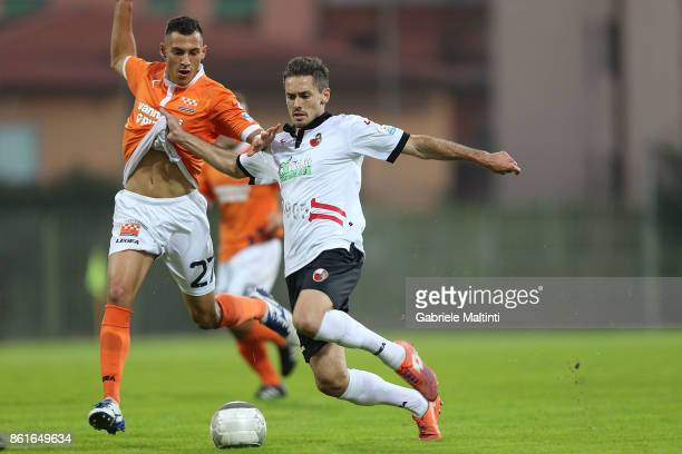 Viviano Minardi of US Pistoiese battles for the ball with Luca Cecchini of AS Lucchese Libertas during the Lega Pro during the match between US...