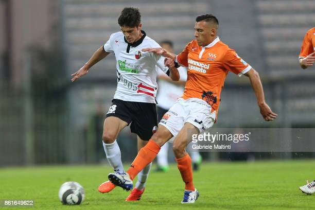 Viviano Minardi of US Pistoiese battles for the ball with Riccardo Baroni of AS Lucchese Libertas during the Lega Pro during the match between US...