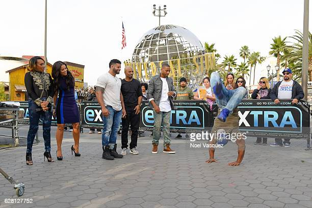 Vivica A Fox and Tracey Edmonds watch the Black Magic dancers at 'Extra' at Universal Studios Hollywood on December 6 2016 in Universal City...