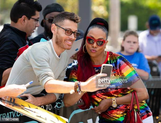 "Vivica A. Fox takes a selfie with a fan at ""Extra"" at Universal Studios Hollywood on June 27, 2019 in Universal City, California."