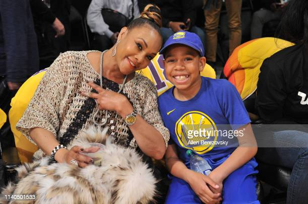 Vivica Fox and a young friend attend a basketball game between the Los Angeles Lakers and the Golden State Warriors at Staples Center on April 04...