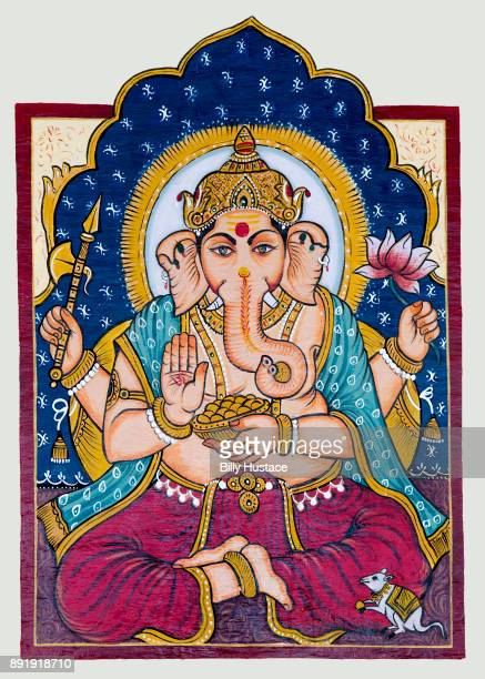 vivid and colorful rendering of the hindu god, ganesha, painted on an exterior wall in the 16th century historical city of udaipur, rajasthan, india. - ganesha stock pictures, royalty-free photos & images