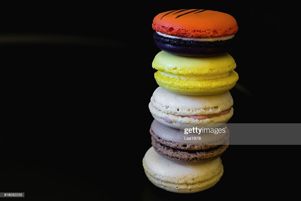 vivid colored macaroons in stack with free space for text : Foto de stock