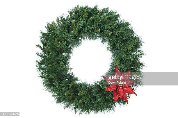 Vivid evergreen wreath, trimmed with a red bow