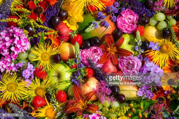 Vivid summer colours of fruit and flowers
