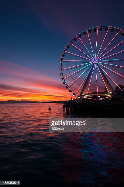 vivid sunset of elliott bay - ferris wheel stock pictures, royalty-free photos & images