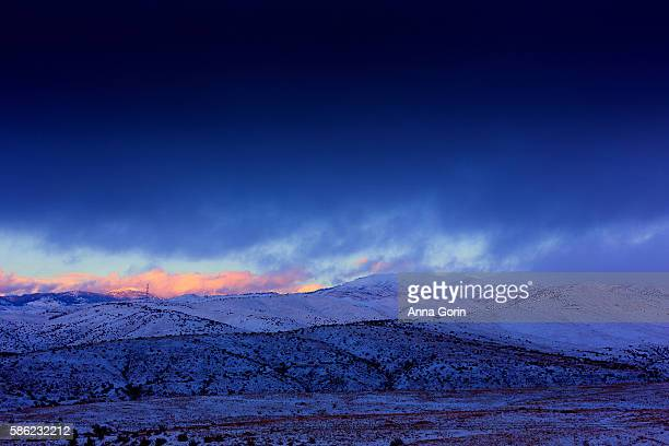 Vivid winter sunset over snowy Boise foothills and Bogus Basin ski resort, Idaho